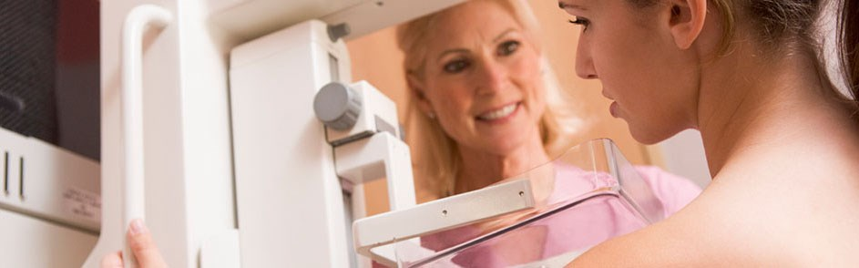 A woman prepping for a mammogram