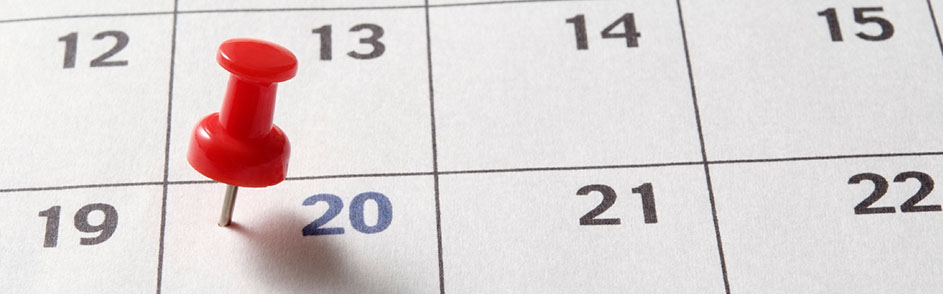 A calendar with a pin in it
