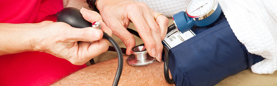 A patients blood pressure is checked