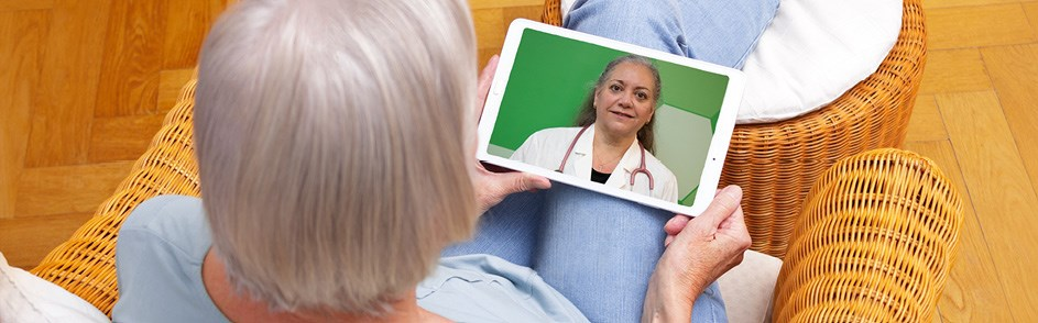 Women talking to her healthcare provider through an iPad.